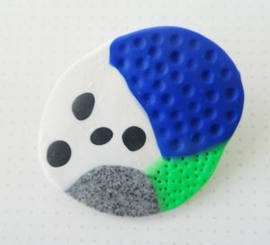 Fruitii broochesMaterials: polymer clay, plastic cord, metal brooch pin back.Dimensions: approx 4.5cm x 5cm (sizes may vary)Inspired by the 1980s 'Memphis Group,' these bright and colourful Fruitii brooches are sure to draw attention to any outfit! Fruitiis are all hand-formed with polymer clay and vary in texture, shape and size. A brilliant little gift or funky addition to any outfit, these one of a kind brooches are pretty cute for the fashion conscious among us. Fruitii brooches are and…