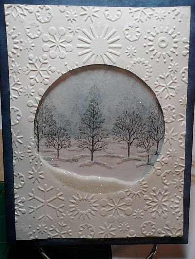 Used the Cuttlebug embossing snowflake folder, Lovely as a tree stamp, and Tim Holtz Distress stickles dry glitter, clear rock candy.: