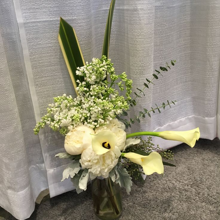 White lilac, peonies and calla with eucalyptus
