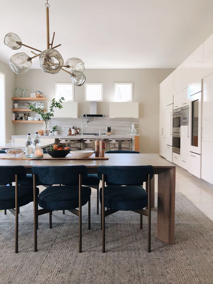 Modern open concept dining/kitchen space  Love that light