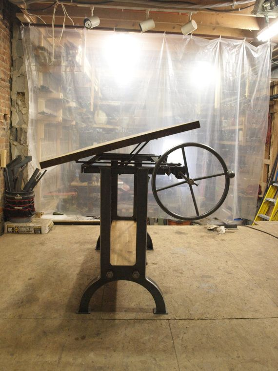 Oak Industrial Drafting table by CamposIronWorks - mine is smaller, but really awesome. Use it every day.