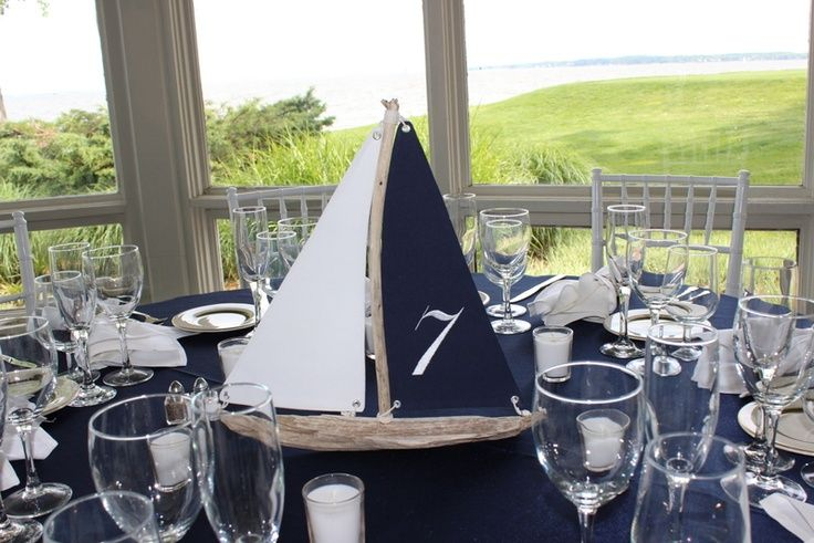 driftwood sailboats used for table centerpieces at nautical wedding. pinned with Pinvolve - pinvolve.co