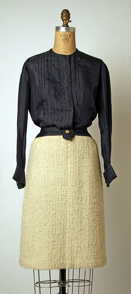 """Suit House of Chanel (French, founded 1913) Designer: Gabrielle """"Coco"""" Chanel (French, Saumur 1883–1971 Paris) Date: 1963–68 Culture: French Medium: wool, silk c) silk d,e) metal"""