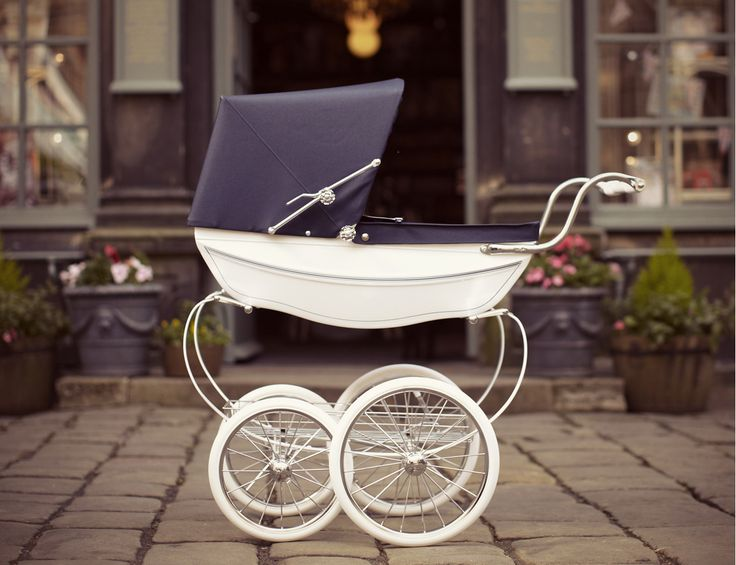 Buy the White Oberon Traditional Dolls Pram from Silver Cross