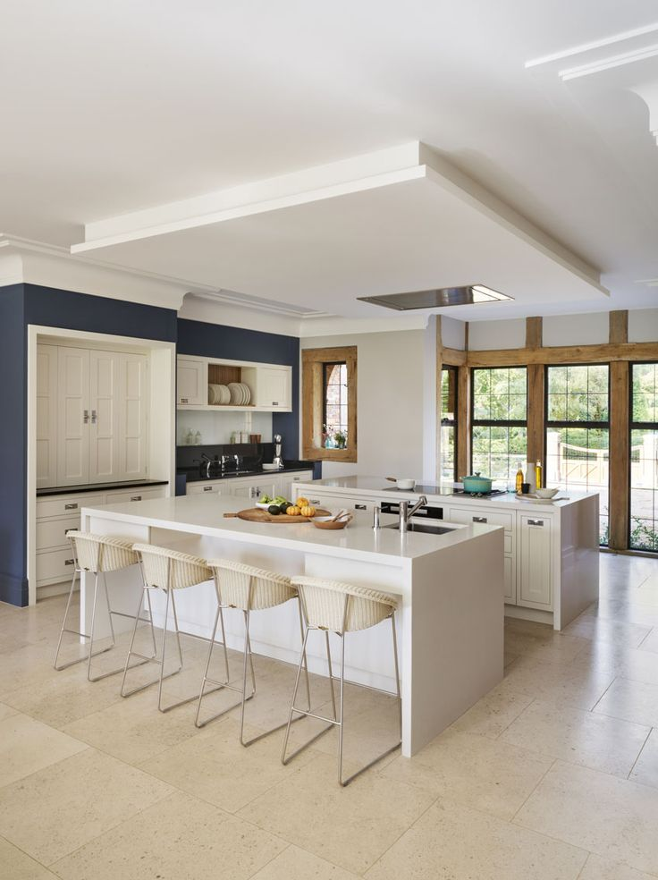 Bringing the breezy outdoors lifestyle of Sydney right across the world to England's Home Counties, this kitchen was designed in response to a very specific brief. It needed to be the heart of a new home for a relocated family with both teenagers and younger children martinmoore.com