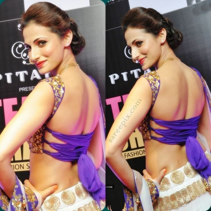 Eye catchy look in white lehenga paired with purple embroidery sleeveless and backless blouse.