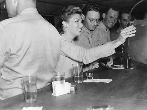 Martha Raye socializing with soldiers in Africa during World War II. A uncaptioned and undated print from a World War II Album. Probably Algiers, Algeria in February of 1943. USO Camps Shows, Inc. - NATOUSA | Flickr.com - gbaku
