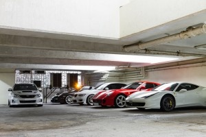 A collection of fine sports cars owned by some dude in Hong Kong.  2 Ferraris with one more on the way!