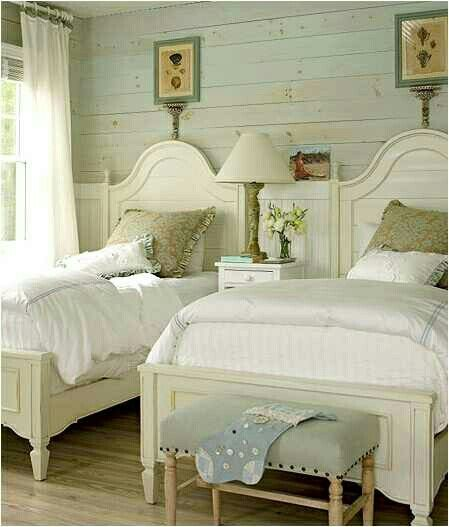 Robin egg blue walls with white beds