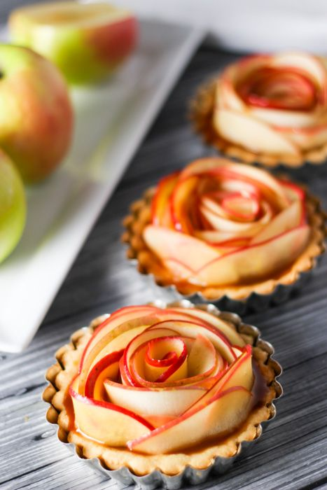 These Salted Caramel Apple Tartlets are not only delicious, but beautiful too! Thin apple slices are arranged to look like a rose & drizzled with caramel.