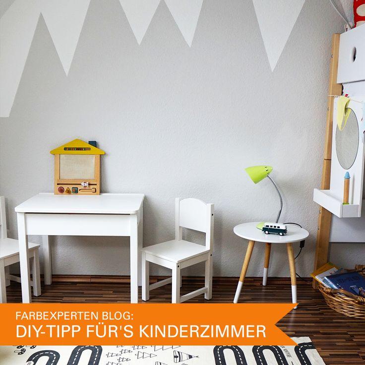 Graue Berge an der Wand im Kinderzimmer von Lilli & Luke
