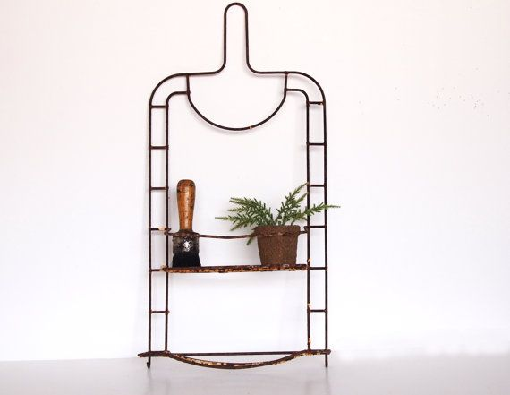 DIY Inspo: This rusted out industrial shower caddy makes a perfect potted plant rack.