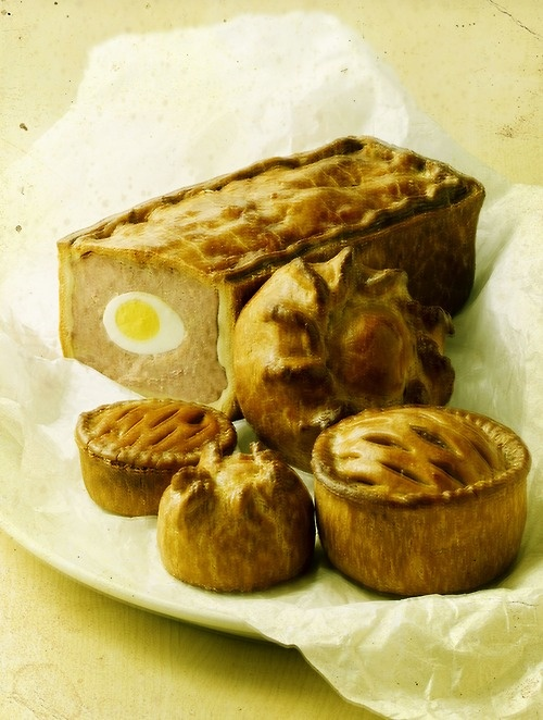Britain's greatest contribution to world cuisine- the humble pie. Empires were founded on bellies full of Melton Mowbray.  Clockwise from back- gala pie and 'porkies' (with hand formed crusts).