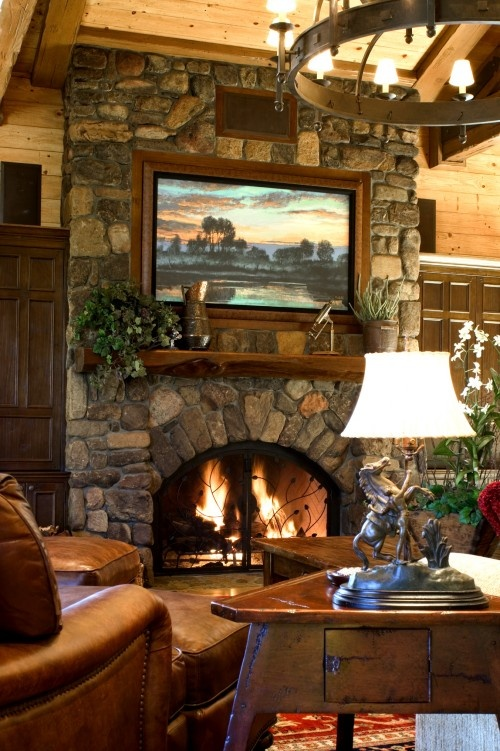 by Maraya Droney Design  Mountain Home Living Room with Stone Fireplace... The fireplace above appears to be a masonry fireplace with custom arched doors (either glass or screen doors)