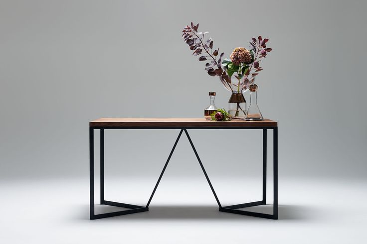 Nevian dining table; Graphic. Walnut and black steel base.