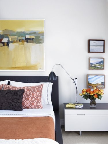 Love the painting/frame above the bed and like the idea of stacking three small paintings above one another.