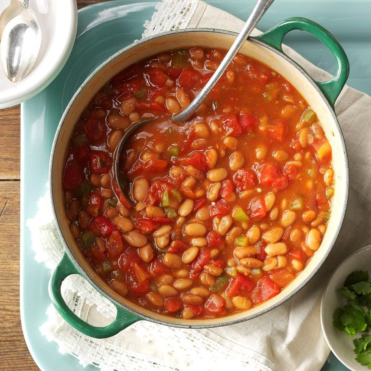 "Cantina Pinto Beans Recipe -Cumin, cilantro and red pepper flakes lend a Southwestern flair to tender pinto beans in this recipe from Mrs. L.R. Larson of Sioux Falls, South Dakota. ""This dish was inspired by one served at a Dallas, Texas restaurant. The chef added chunks of ham, but my version is meatless,"" she writes. ""It makes a great Tex-Mex side or a filling lunch when served with corn bread."""
