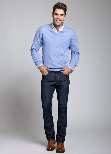 Nail off-duty dressing with this combination of a light blue v-neck pullover and navy blue jeans. Brown leather derby shoes will instantly smarten up even the laziest of looks.  Shop this look for $165:  http://lookastic.com/men/looks/white-longsleeve-shirt-light-blue-v-neck-sweater-navy-jeans-brown-derby-shoes/5967  — White Longsleeve Shirt  — Light Blue V-neck Sweater  — Navy Jeans  — Brown Leather Derby Shoes