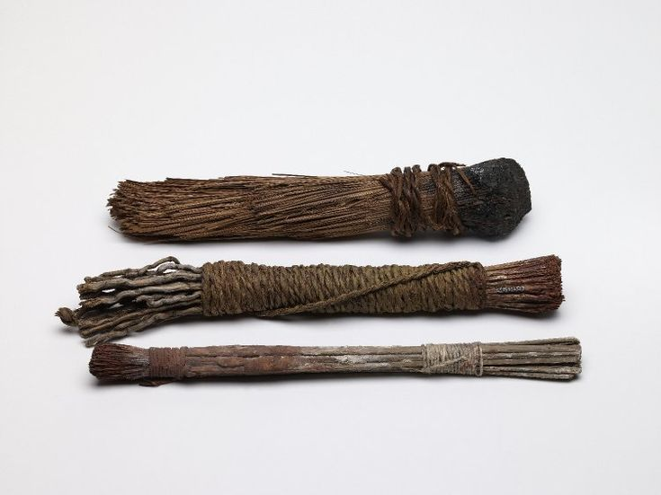 Fibre brush held together with bitumen at one end and bound.