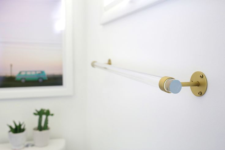 Lucite Towel Bar DIY (click through for tutorial), $6 per bracket + wood dowel for bathroom towel bar