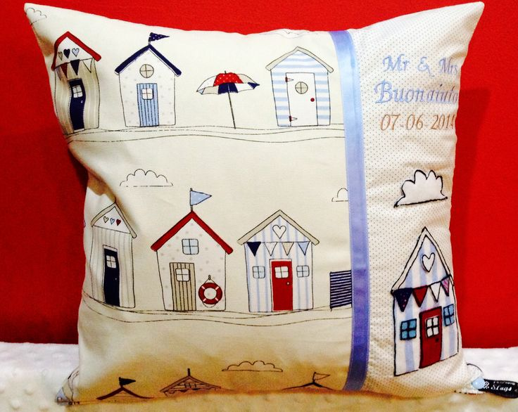 Handmade cushion foe a wedding gift, personalised and hand cut and sewn appliqué beach hut & cloud