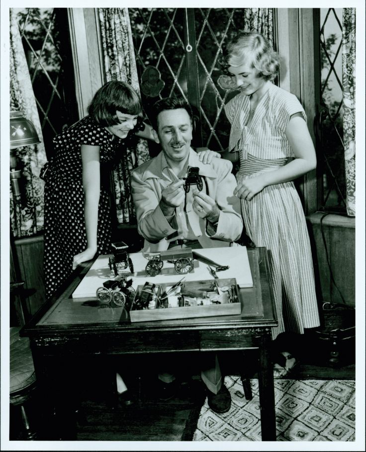 Walt Disney and his daughters, Diane and Sharon.