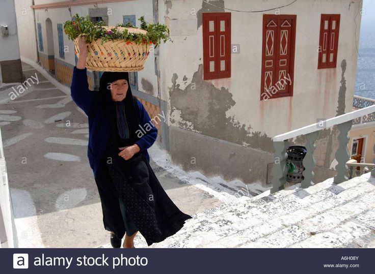 Good Friday Epitaphios.   Woman holding a basket of flowers Olympos Karpathos Dodecanese's islands. Greece Velissarios Voutsas IML Image. www.alamy.com.