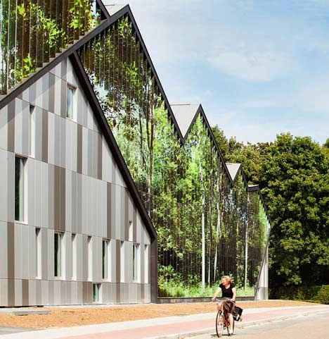 The Academie MWD near Brussels, Belgium, has a system of louvres on the facade so the building 'changes'  depending on the viewing angle;  View #2;  designed by Carlos Arroyo