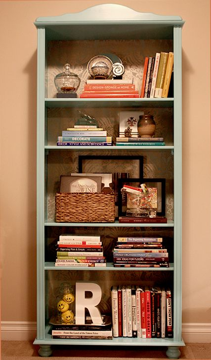 Bookcase Styled: wicker basket with things in it, the two horizontal stacks  of books side by side. Like 2 bottom shelf minus yellow things in vase - 147 Best Bookcase Styling Images On Pinterest Bookcases, Live