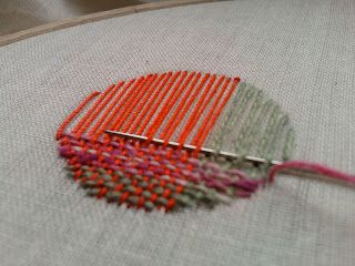 Embroidery meets weaving = darning. But if you don't have a hole to mend, it's a decorative technique.