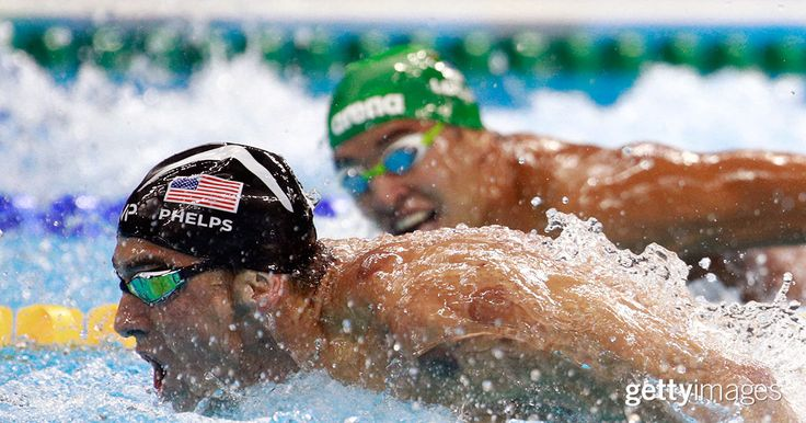 Michael Phelps (L) of the United States leads Chad le Clos of South Africa in the Men's 200m Butterfly Final at the Rio 2016 Olympic Games on August 9, 2016 in Rio de Janeiro, Brazil.   #2016InFocus