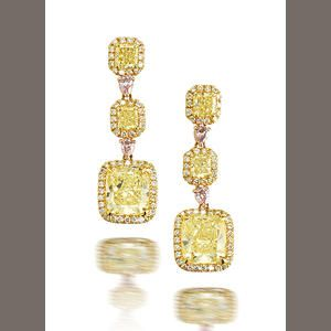 Absurdly beautiful fancy yellow graduated radiant-cut diamonds (the bottom diamonds are 3.29 and 3.01 carats, respectively.) Brilliant cut diamonds surround each yellow stone, and all three diamonds are connected by fancy pink diamonds set in 18kt yellow and pink gold.