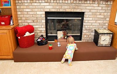Great way to baby proof a brick fireplace! Now on my to-do list.