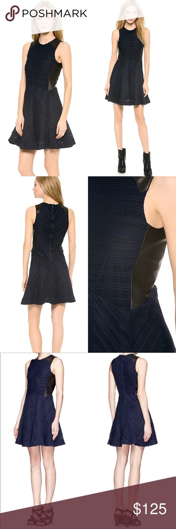 rag & bone Basha Leather Trim Dress - Indigo, 2 Glazed black leather panels play against delicate indigo knit on this Rag & Bone dress, effecting a hard-meets-soft aesthetic. A fit-and-flare cut keeps the shape flirty. Exposed back zip. Lined.  Fabric: Slinky, loose knit. 96% polyamide/4% lycra spandex. Leather clean. Made in the USA. rag & bone Dresses Mini
