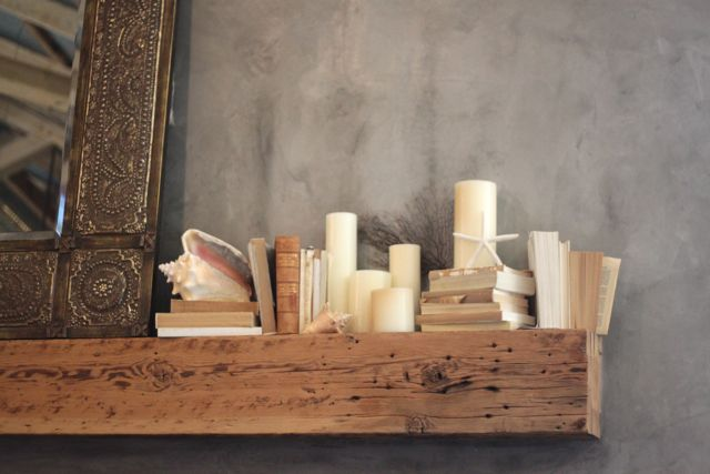 mix of candle and books on mantle
