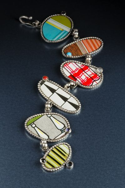 A found art sort of bracelet by metalsmith Lisa Colby. Inspiration for this collection came from a vintage metal dollhouse she found. The printed steel was rich with color and pattern. She combined the dollhouse metal with sterling silver and semiprecious stones to create lively juxtapositions.  Love it. see more... http://crafthaus.ning.com/photo/photo/listForContributor?screenName=0jknx80xrwv93