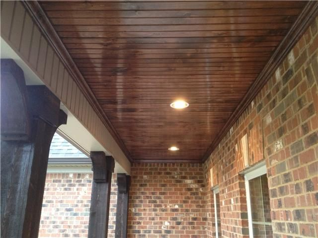 love the bead board ceiling with can lights on the porch