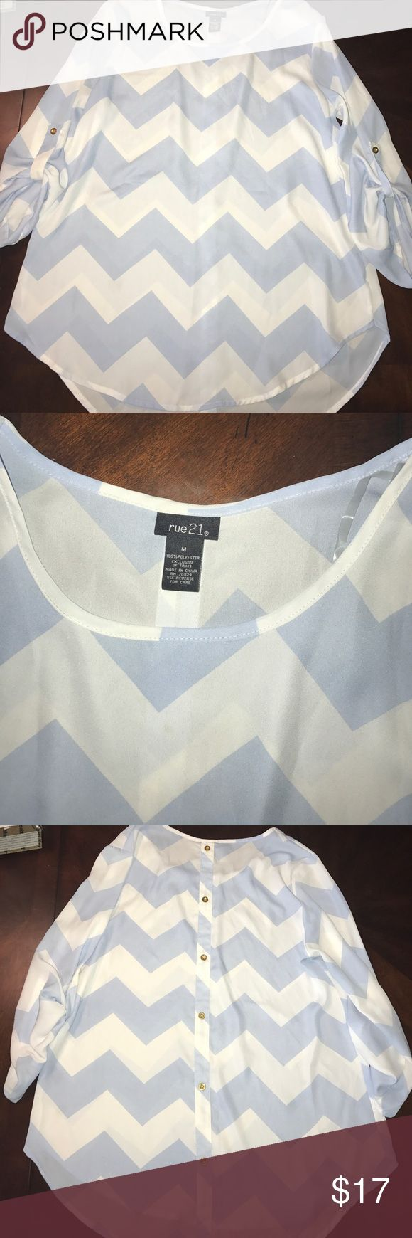 Trendy Chevron Blouse Super trendy pale blue and white chevron Blouse with gold button accents at the elbows for three quarter length sleeves and along the back. Never worn. Rue 21 Tops Blouses
