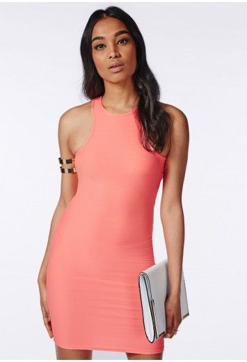 Channel major Miami Heat vibes in this coral midi dress. With racer style neckline and fanciful textured fabric this dress will ensure all eyes are on you. Team with multi coloured strappy heels and oversized clutch for that lust worthy fin...