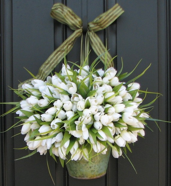 flowers in buckets...tied with a bow...on the door..on the post...on the shepherd hooks..