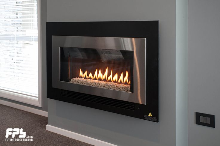 ARRIVA 752 Gas Fireplace from Rinnai (www.rinnai.co.nz) a direct vent inbuilt gas fireplace (natural draft) with a glass front and convection fan, operated with a remote control (7-day programmable timer).