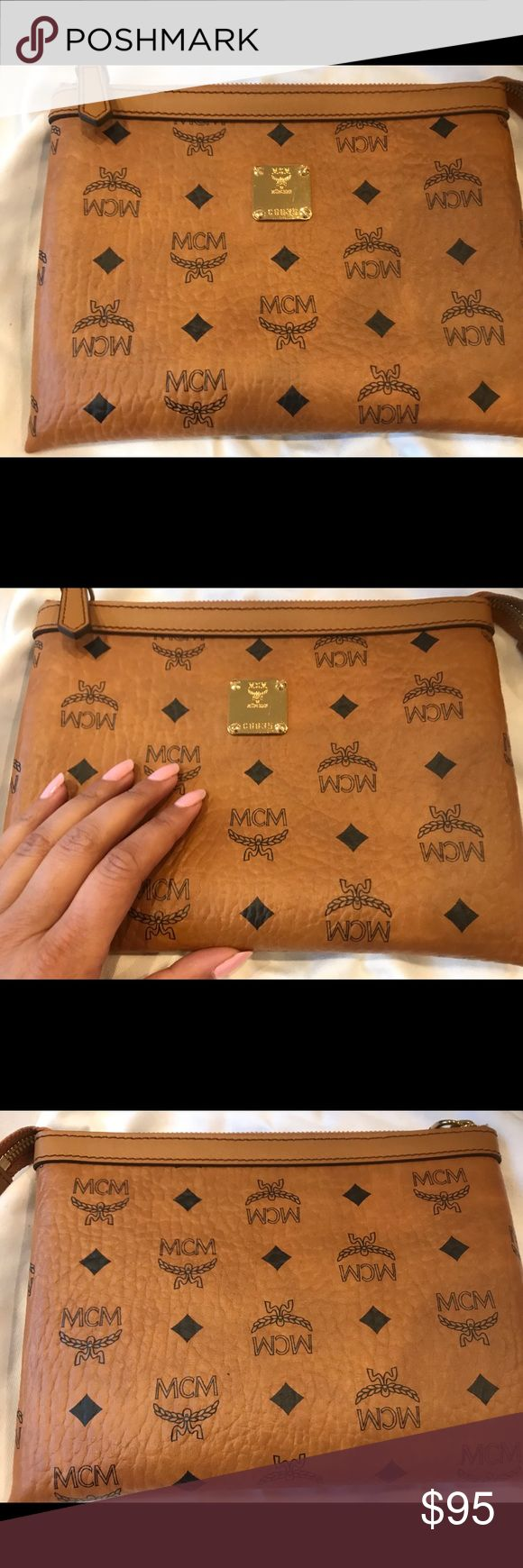 MCM Clutch. Like new. Worn once. Still like new with dustbag. MCM Bags Clutches & Wristlets