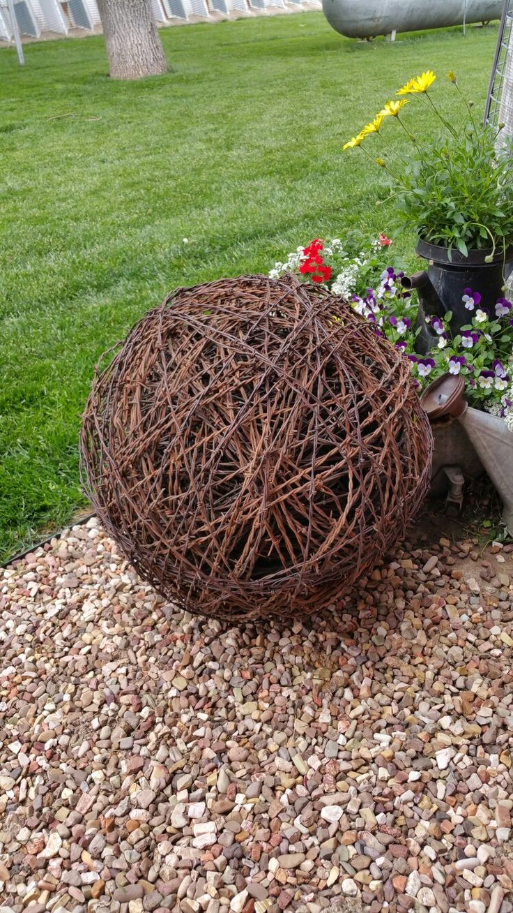Large solid ball made from upcycled recycled reclaimed barbed wire by The Rusty Ringneck Barbed Wire Art in Hill City, KS Shipping available. www.therustyringneckbarbedwireart.com. Follow us on Facebook and Twitter.