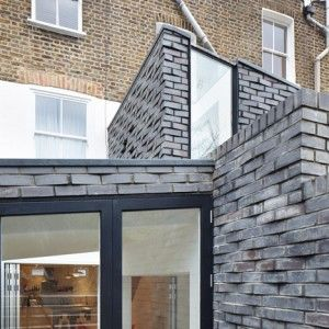 Fraher+Architects+includes+textured+brick+cladding+on+north+London+house+extension