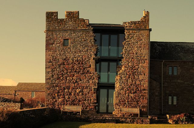 Blencowe Hall, located in Cumbria, England. A 14th century manor whose towers were left to decay for over 300 years. The large gash in the masonry wall of the south tower is believed to be the result of an attack during the English Civil War.