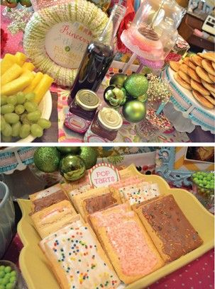 Breakfast bar at girls party. orange juice in glasses, poptarts, mini muffins, fruit with yogurt dip or parfaits