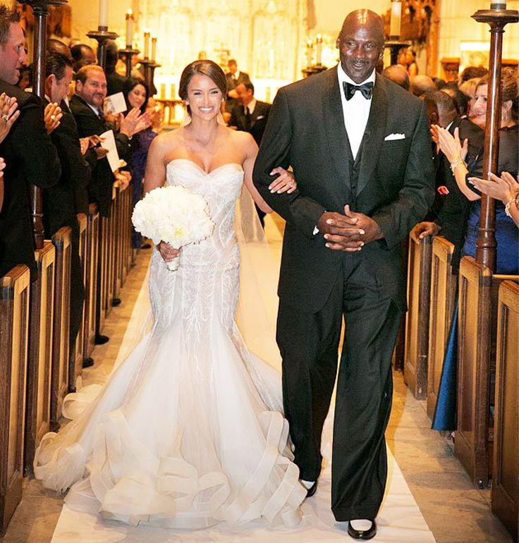 Happily married husband and wife: Michael Jordan and Yvette Prieto at their wedding ceremony