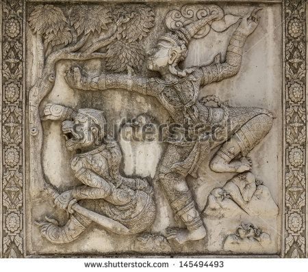 Ramayana bas-relief sculpture of Hanuman(half-monkey hero fighter) at Wat Panun Choeng, Thailand