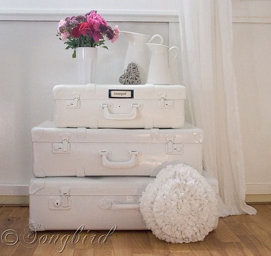 Learn how to create this stack of painted white suitcases via www.songbirdblog.com