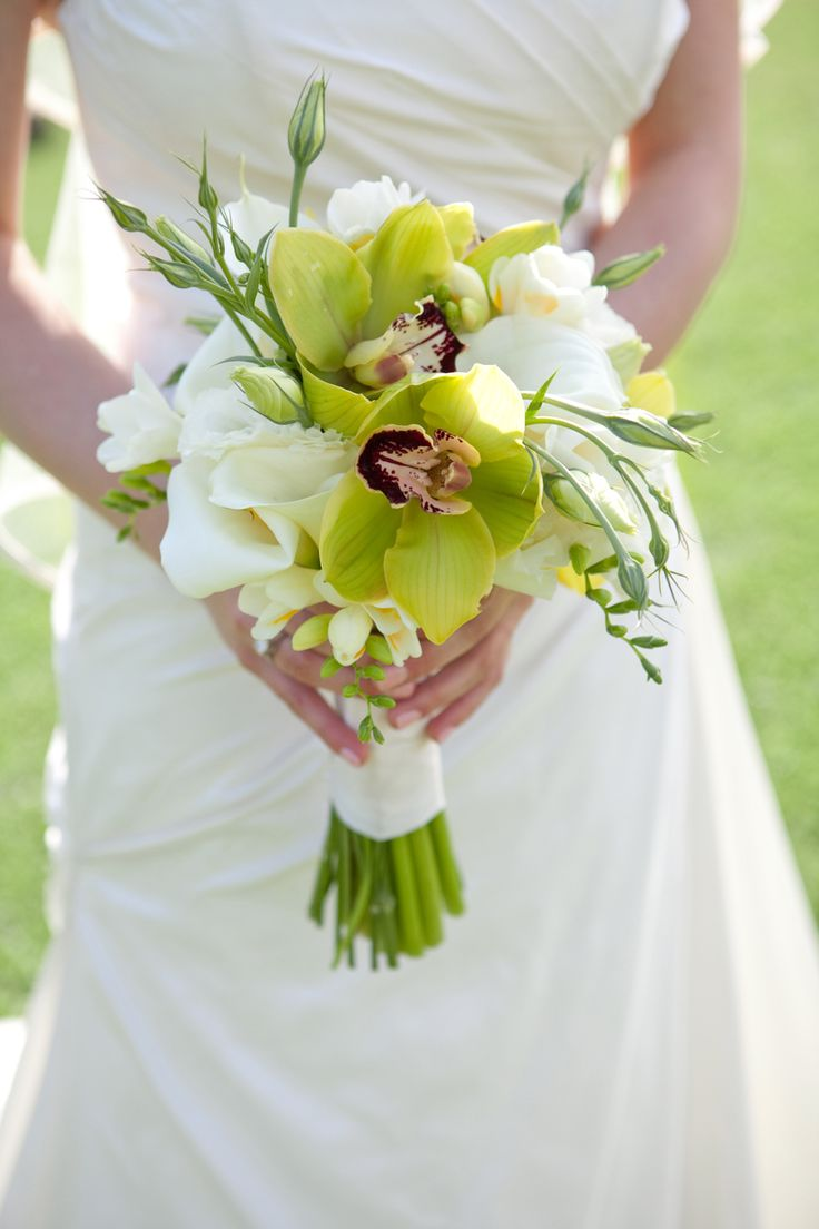 Passion Flowers Design  www.passionflowersdesign.com; bridal bouquet with green Cymbidium Orchids from Santa Barbara Orchid Estate, mini Calla Lilies, Lisianthus, and Freesias. Photo by Sherri J Photography, at the Santa Barbara Zoo